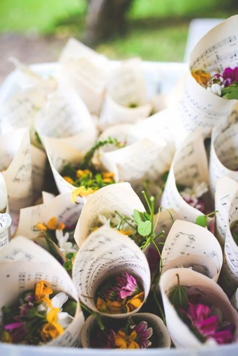 flower petals in cones of note paper are a cool idea to serve petals for the wedding exit