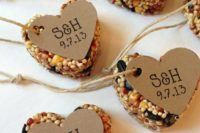 heart-shaped bird seed rehearsal dinner favors with tags is a cool idea for any wedding season and theme