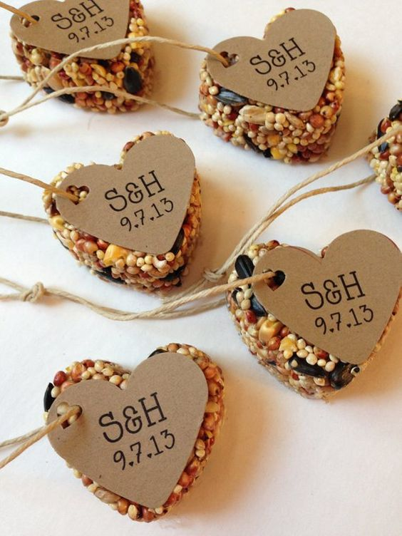 heart shaped bird seed rehearsal dinner favors with tags is a cool idea for any wedding season and theme