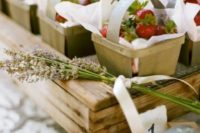 mini wooden baskets with fresh strawberries and paper are perfect for summer weddings and rehearsal dinners