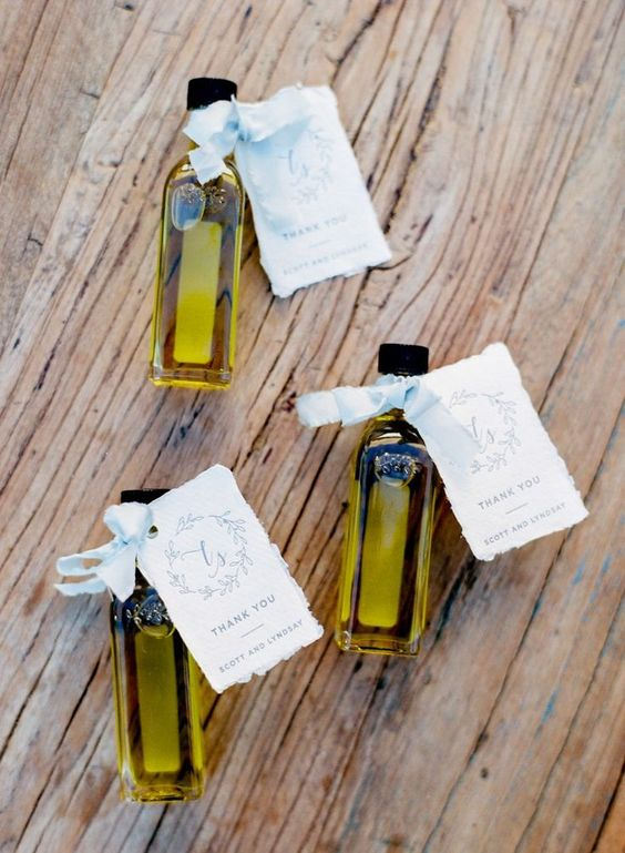 olive oil mini bottles with personalized cards and ribbon bows make a cool favor for a Mediterranean wedding