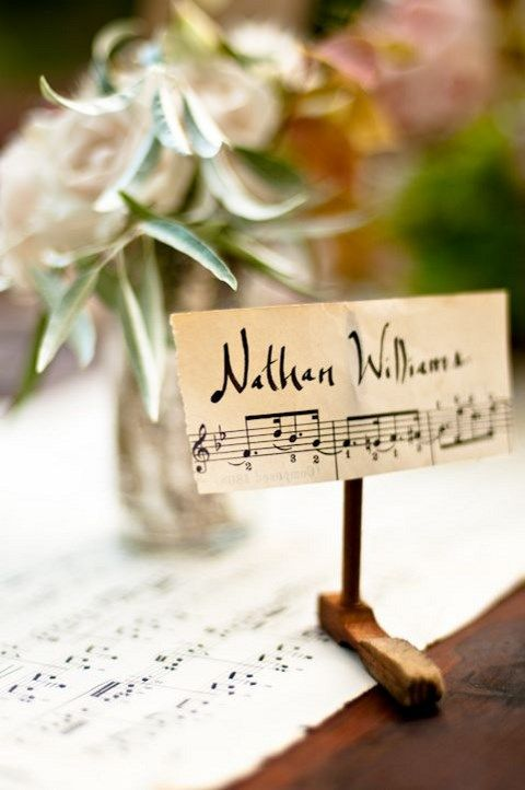 place cards made on note paper and placed on wooden stands are amazing to decorate the tables
