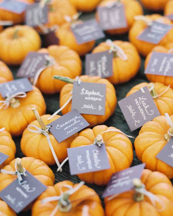 pumpkins with tags can be a nice idea for a fall wedding rehearsal dinner