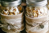 salted, sweet and caramel popcorn in jars with lace and burlap is a cool and budget-friendly idea to realize