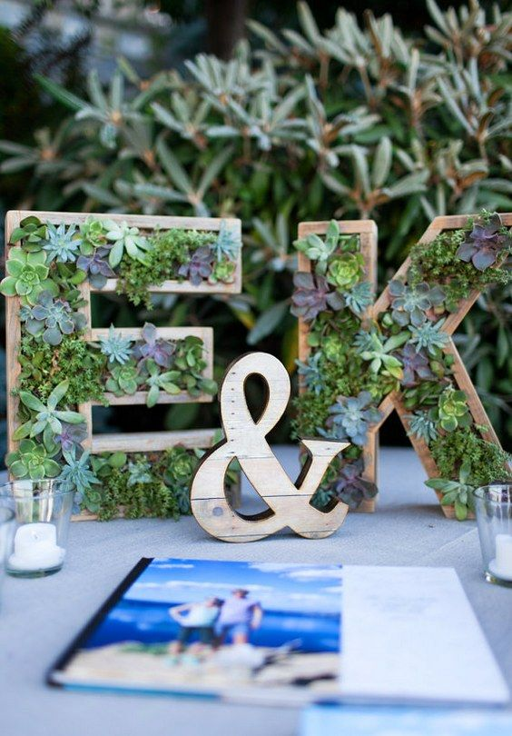 succulent decor is very popular today, so cover your letters or monograms with them for an edgy touch