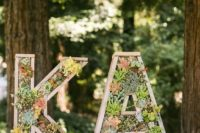 wooden monograms decorated with foliage and succulents are perfect for a modern rustic or woodland wedding
