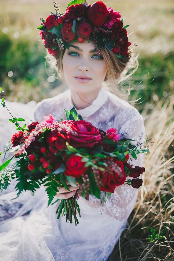 a bold fall floral crown with leaves, deep red and fuchsia blooms and twigs is a bright solution