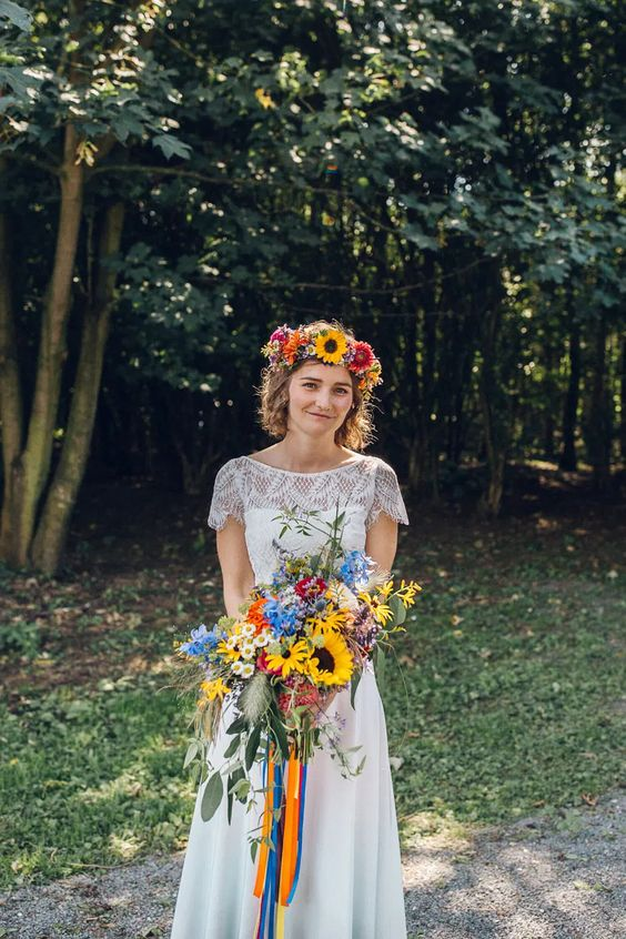 a bright summer to fall wedding crown with hot pink, lilac, fuchsia blooms, sunflowers is a very cool and pretty idea for a boho bride