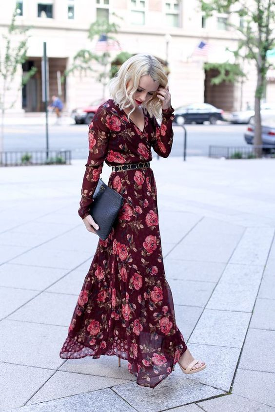 a burgundy floral maxi dress with long sleeves, V-neckline, a belt, nude shoes and a clutch