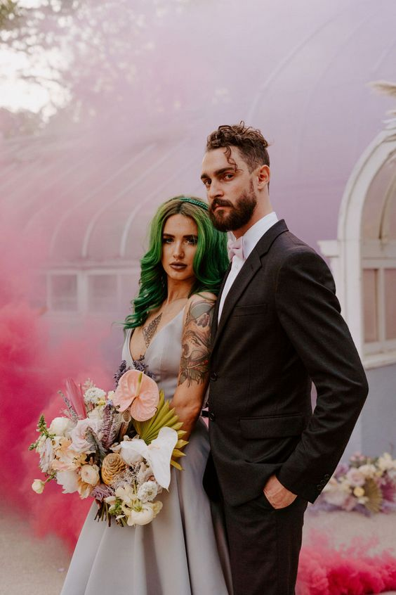 a fabulous wedding portrait with pink smoke is amazing and very bold, whatever the real backdrop is