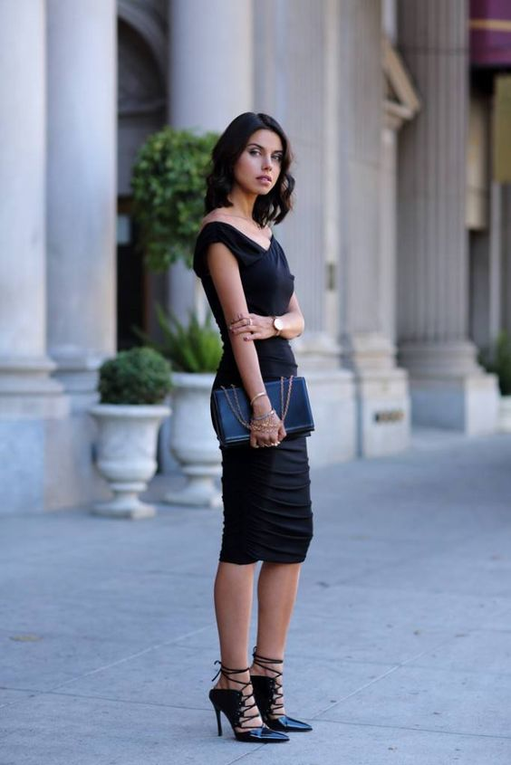 a fail-proof look with a black midi fitting dress, a black clutch and blakc strappy heels