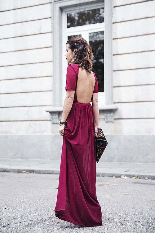 a fuchsia maxi dress with an open back, short sleeves and a patterned clutch for a formal fall wedding guets look