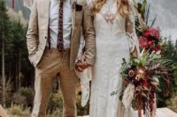 a hippie groom with a neutral printed suit, a white shirt, a printed tie, brown shoes and a brown hat