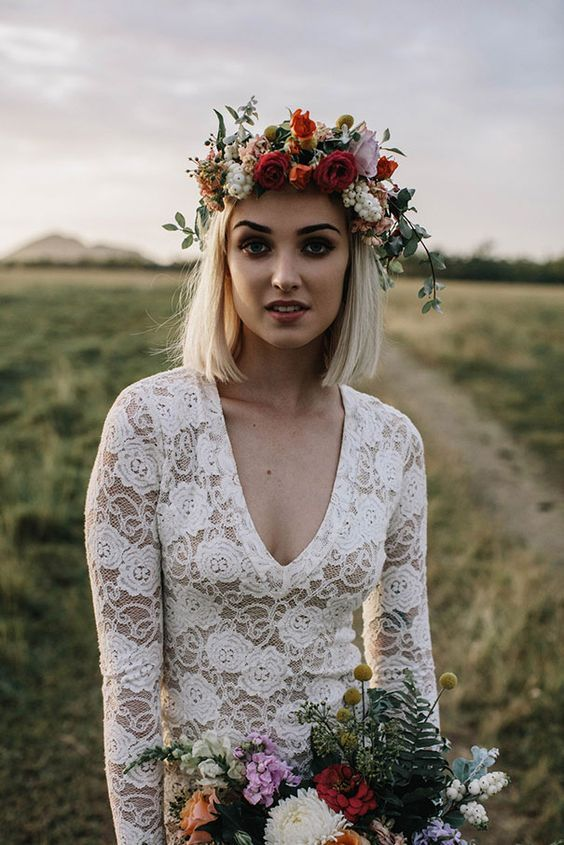 a lovely fall floral crown with lilac, rust, peachy blooms, berries and greenery is a very textural and catchy idea
