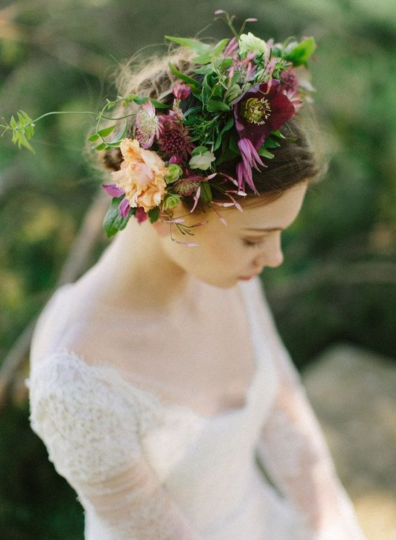 a moody fall floral crown with purple and peachy blooms and lots of textural greenery is a cool idea