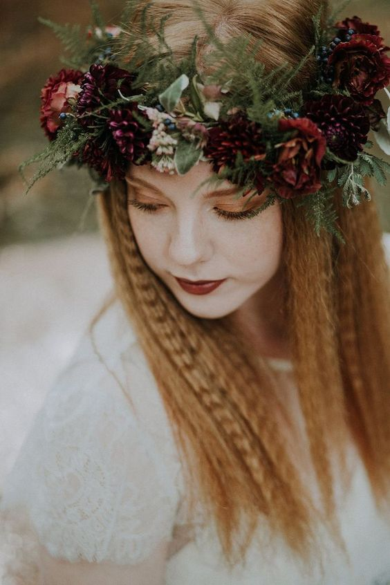 a moody floral crown with deep red and burgundy blooms, berries and greenery of various kinds is a very pretty idea