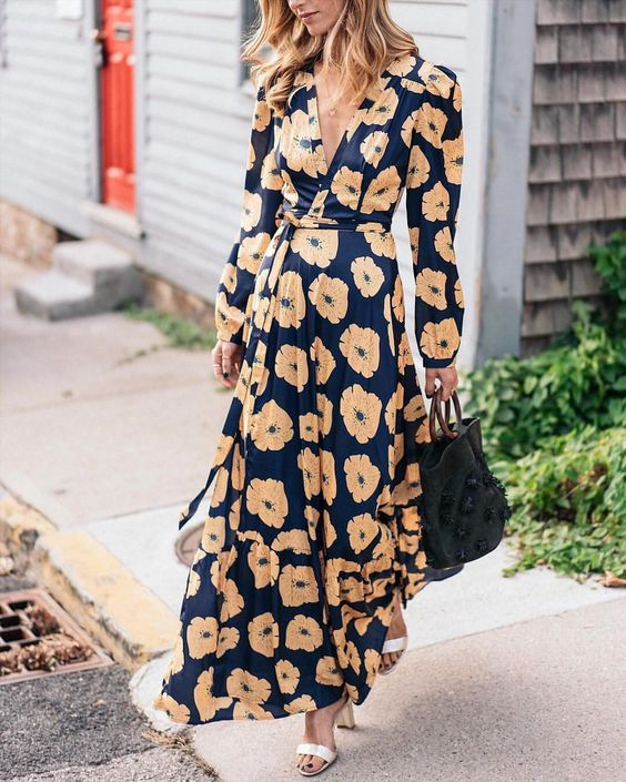 a navy floral maxi wrap dress with long sleeves, white shoes - just add a statement clutch and go