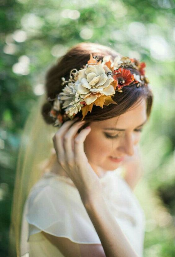 a pretty fall floral crown with rust and neutral blooms, neutral succulents and bright fall leaves is a cool idea