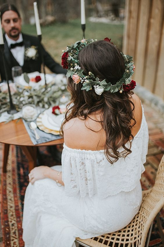 a pretty fall floral crown with white, blush, deep red blooms, berries and greenery is a stylish idea for a boho bride
