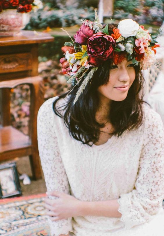 a pretty oversized fall floral crown with burgundy, purple, white, red blooms, foliage and grasses and twigs is a catchy idea for a boho bride