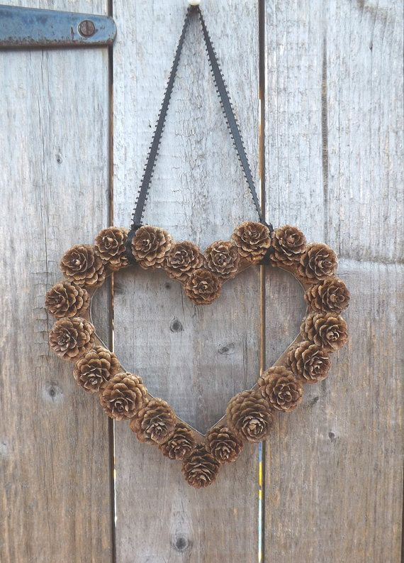 a pretty pinecone heart-shaped wreath is an easy to DIY and cool decoration for a wedding, a fall or a winter one