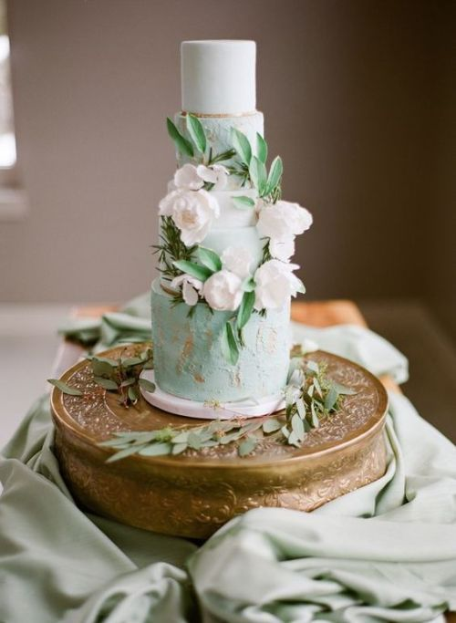 a refined wedding cake with white and textural mint and copper tiers, sugar white blooms and sugar foliage