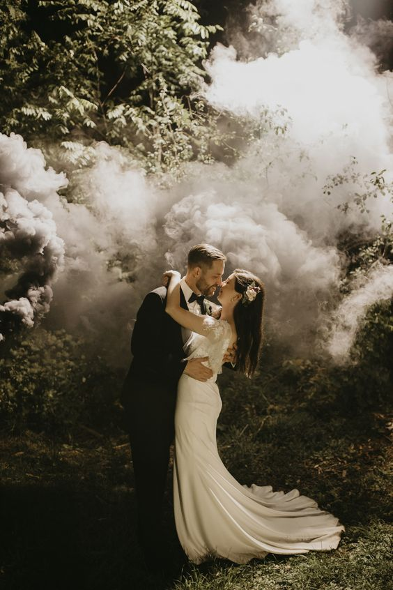 a romantic and elegant wedding portrait done with neutral and grey smoke is amazing and doesn't distract attention from the couple