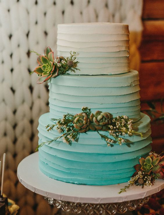 a textural and ombre tiffany blue wedding cake decorated with succulents and little blooms is a bold idea