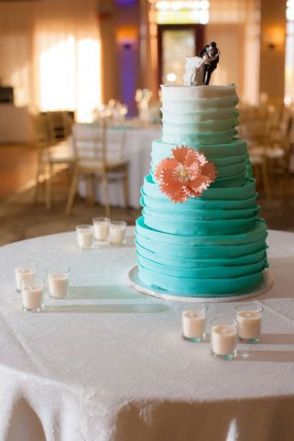 a textural ombre tiffany blue wedding cake with a cool topper and a sugar coral bloom for decor