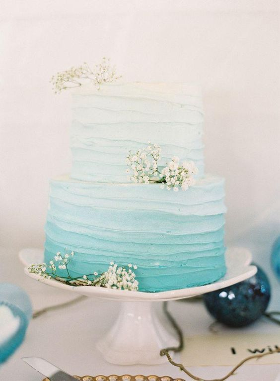 a textural ombre tiffany blue wedidng cake decorated with baby's breath is a gorgeous idea for a coastal wedding