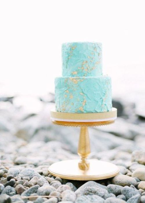 a textural tiffany blue wedding cake decorated with gold leaf is a trendy and edgy idea