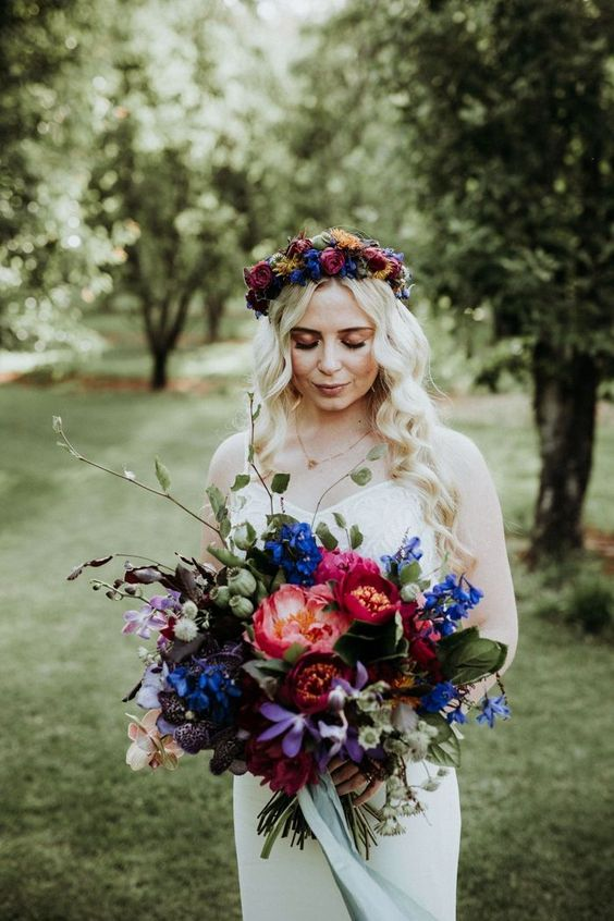 a vibrant jewel-tone wedding crown of purple, blue and yellow blooms is a very lovely and bold idea to rock