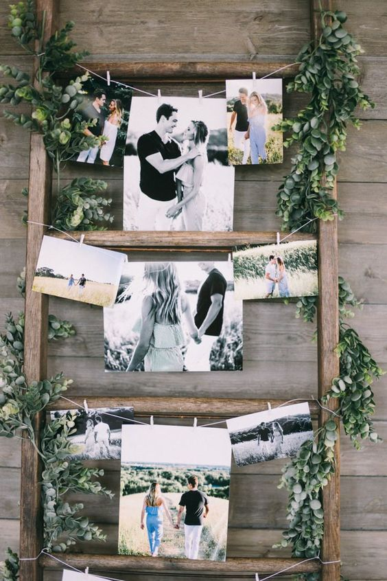 a wedding decoration of a ladder, greenery and photos is a very cool and chic piece for every wedding