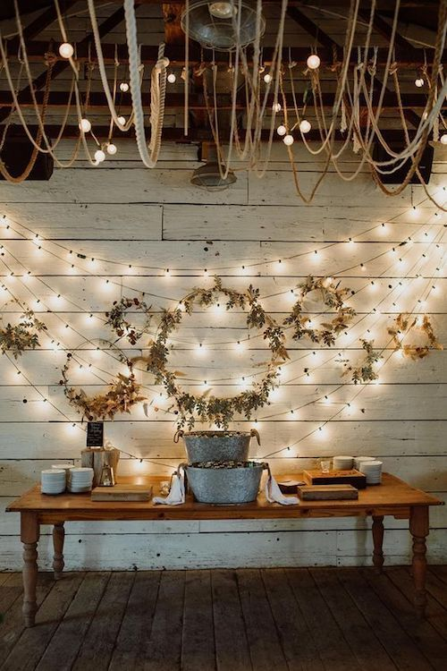 an arrangement of fall wreaths covered with pampas grass and leaves is a lovely idea for this fall boho or rustic wedding