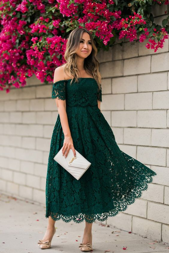 an emerald lace off the shoulder midi dress, a neutral clutch and nude bow shoes