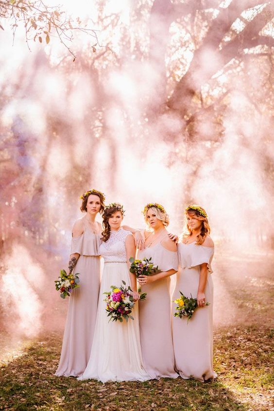 an ethereal bride and her gals photo accented with a pink smoke bomb and sunshine that goes through it