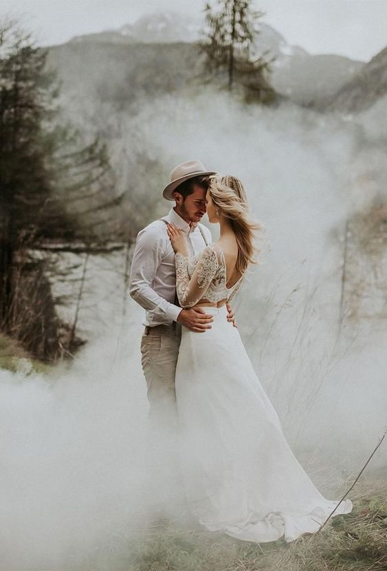 an ethereal wedding portrait in the woods with smoke around is a beautiful and breezy idea to rock