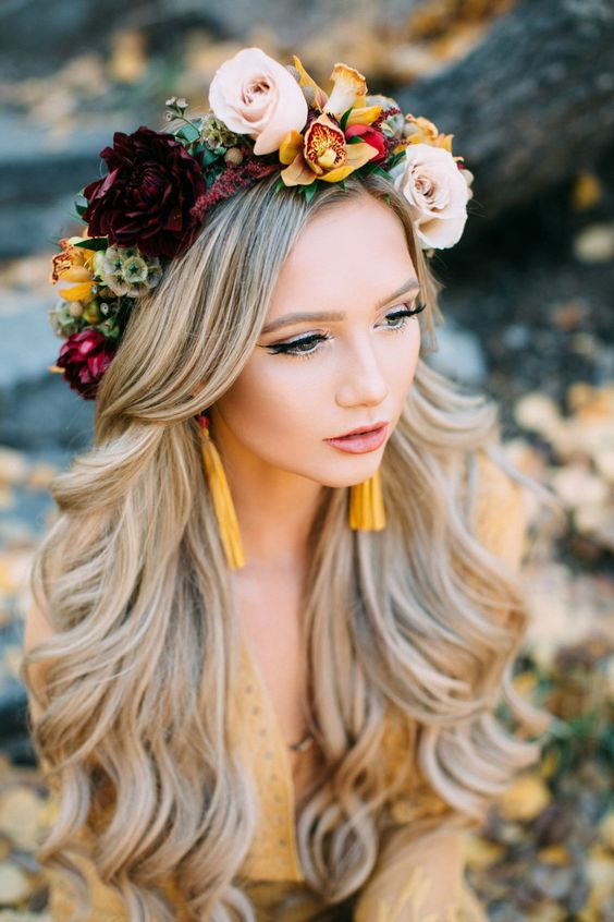 an exquisite fall floral crown with mustard, blush and burgundy blooms, greenery and seed pods is a very chic idea