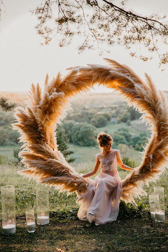a stylish pampas grass wedding arch