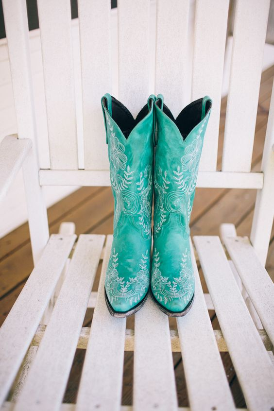 jaw-dropping turquoise cowboy boots with white floral patterns are gorgeous for a boho or rustic bridal look