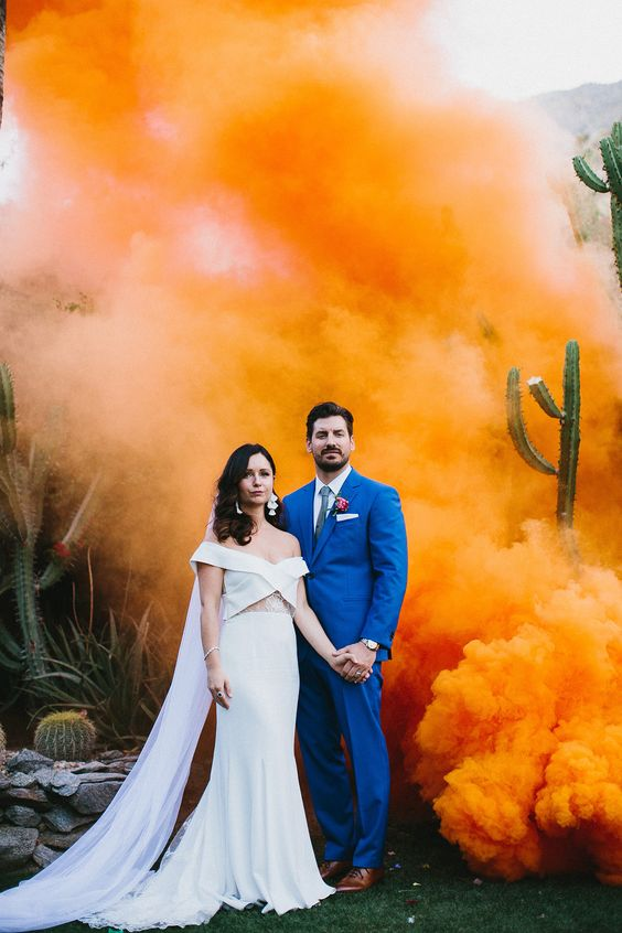 orange smoke and cacti are perfect for a desert wedding backdrop