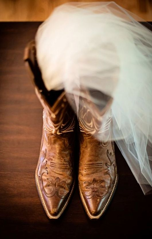 pretty brown patterned cowboy boots are always a good idea to finish off a boho or rustic bridal look
