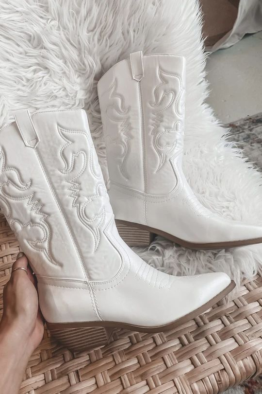 white embroidered cowgirl boots like these ones will be a perfect solution for a modern boho bridal look or for pulling off a rustic one