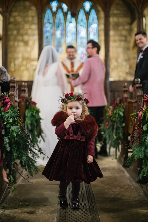 a burgundy velvet A line knee dress, a matching faux fur coverup, burgundy tights, black shoes and a flower crown