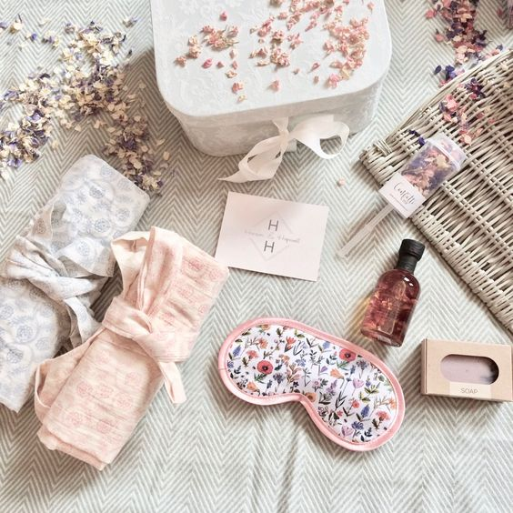 a chic bride's gift box with a sleep mask, towels, dried flower petals, a soap are a chic setup for a bride