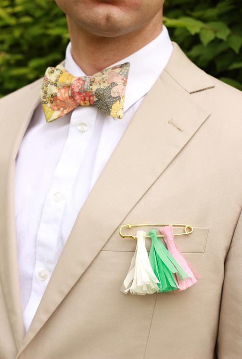 a colorful pin and tassel boutonniere will add color and fun to your look