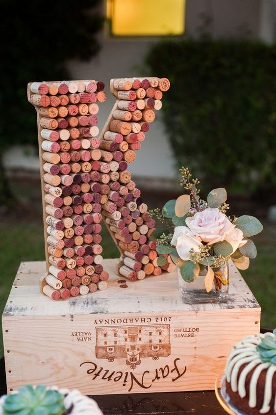 a colorful wine cork monogram is a cool and simple idea to personalize your wedding decor