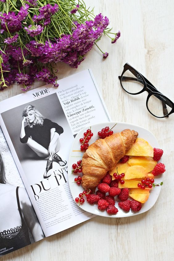 a croissant served with raspberries and peaches is a very tasty and chic breakfast for your bride
