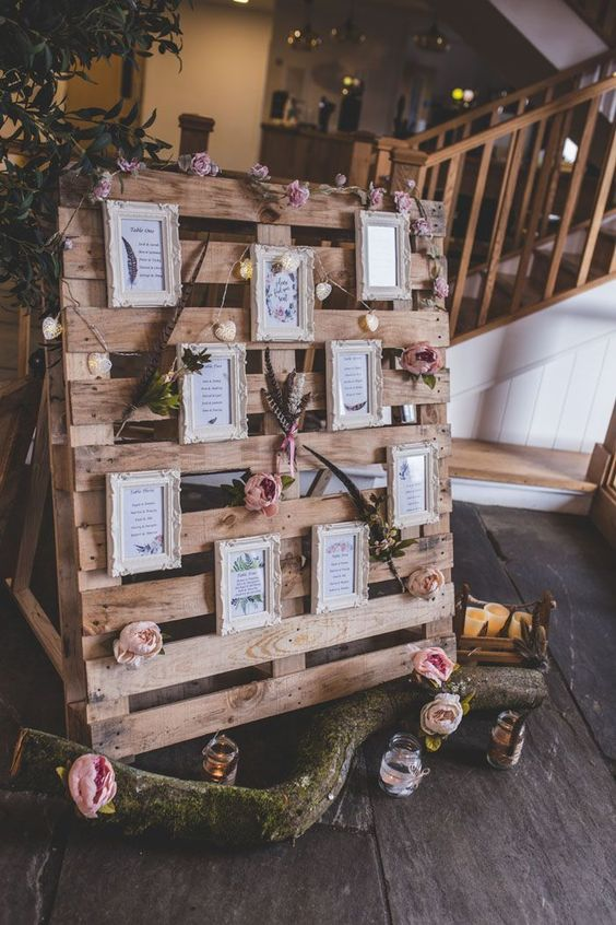 a cute wedding pallet sign with fresh blooms, foliage and favorite quotes in vintage frames plus lights