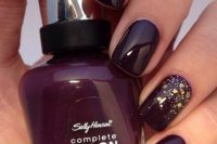 a deep purple manicure with gold glitter and polka dots is a very bold and refined fall wedding idea